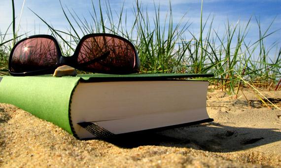 book on the beach sand