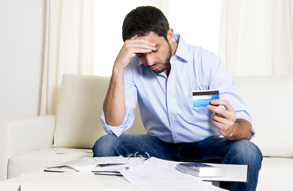 man overwhelmed with financial worries
