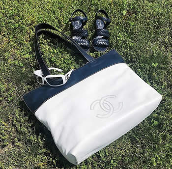 Chanel leather tote, sunglasses and quilt stitch sandals