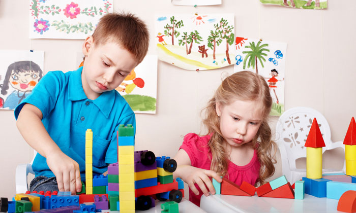daycare boy and girl with building blocks