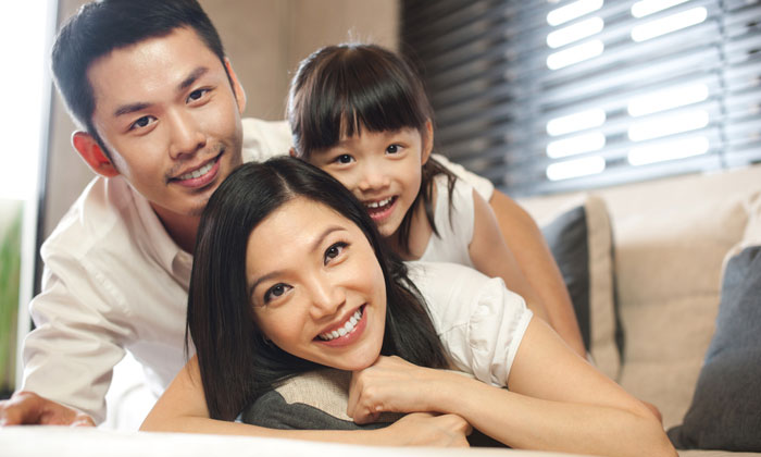 happy parents with young daughter