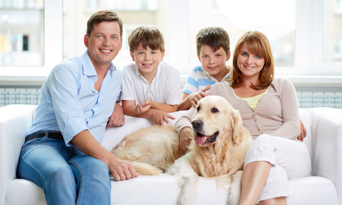mom dad two boys and happy dog
