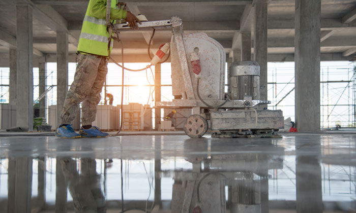using machine to flatten new concrete