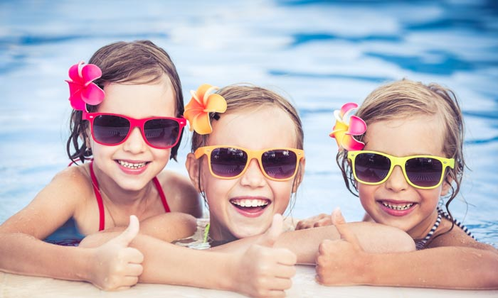 happy sunglass little girls in pool