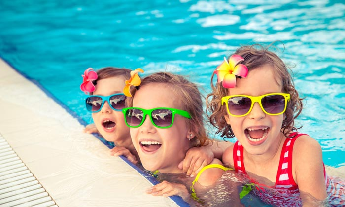 laughing sunglass young girls in pool water