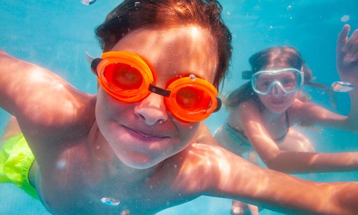 happy underwater swimming kids