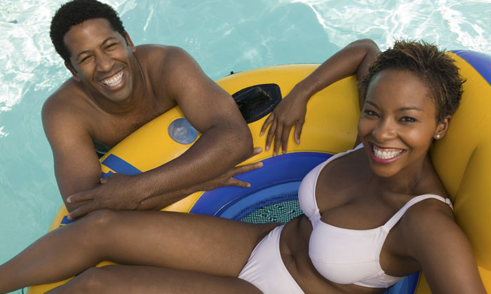 couple relaxing on floating tube