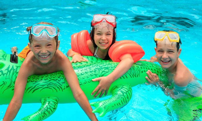 goggle wearing kids with floating alligator
